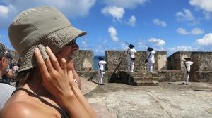 Megan holds her ears while volunteers demonstrate shooting muskets