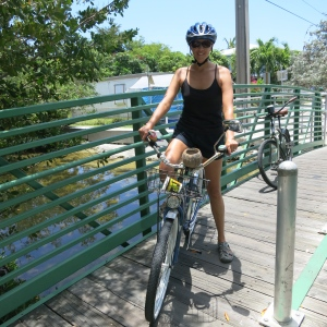 Riding beach cruisers in Key West. Check out the coconut cup holder, bell, and horn on the handlebars!