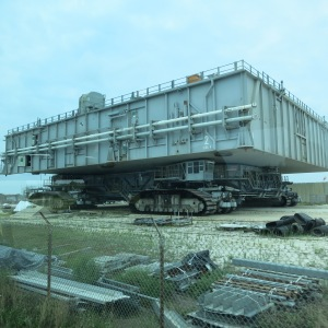 "The ""Crawler"" at Kennedy Space Center with a platform on top. Rockets are transported on top of this from the assembly to the launch. Empty it weighs about 6 million pounds, can travel up to 2 mph,  and takes a team of 30 to operate it."