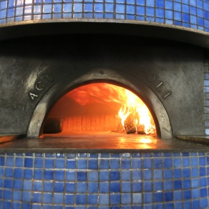 The pizza oven imported from Naples at a stop on our food history tour. It is about 1000 degrees in the oven. They only burn oak and are able to cook a pizza in 90 seconds! It was delicious.