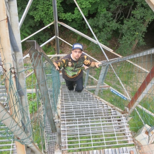 Adam, Megan's brother, climbing the lookout at Ferncliff Forest