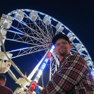 Adam in line to ride the ferris wheel