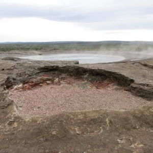 Geysir, the original geyser, is so old it is now retired and just steams. It does not please the tourists they way it used to.