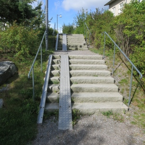 Every stairway we've seen in Sweden has accessibility track for bicycles and baby strollers