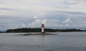 One of the many small lighthouses that help sailors navigate safely. Note the swans in front of it for scale. Swans and large signets are all over the place right now.