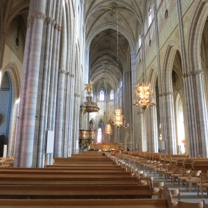 Uppsala Cathedral, looking nearly the length of it. Note the elaborate gold pulpit in the middle.