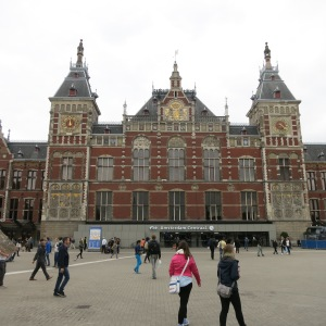 The Central Train Station in Amsterdam. The tower on the right is a clock, on the left is a wind vane.