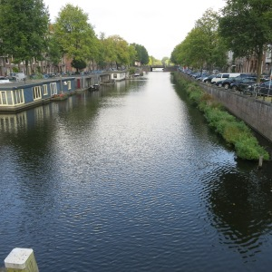 One of the many canals. Note the house boats on the left and the floating herb gardens on the right. We never saw anyone tending or harvesting the herbs but they were a common sight.