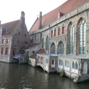 Beautiful old buildings on a Bruges canal.
