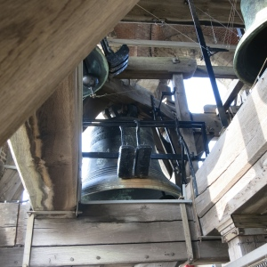 Carillon in the Belfort. See how the clapper has been pulled to the side and each bell has a couple of exterior hammers.