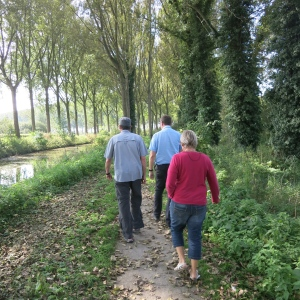 Peter, Jim, and Mieke walking on the outskirts of Damme.