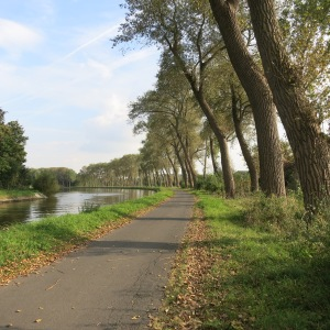A canal with a path for bikes and pedestrians.