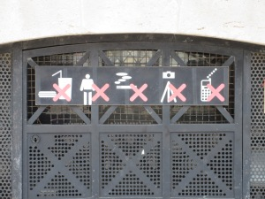 Behavior guidelines posted on top of the Arc de Triomphe. The French really love their speedos!