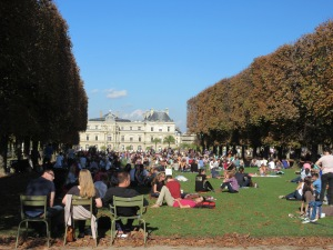 Another park packed with quiet locals enjoying a sunny afternoon.
