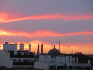 The sunset view from our balcony, last day in Paris. Au revoir!