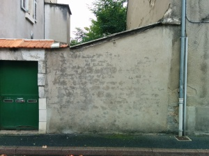 "The blank shed wall next to Jim's old house which the communist party used to whitewash with ""Yanqui go home."" 2014"