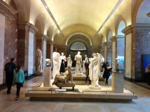 A room of Greek sculptures in the Louvre.