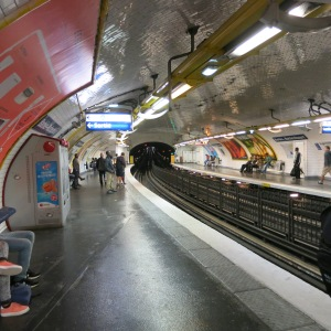 A typical clean, well-lit subway stop. The stations are so close together in some places, you can see down the tracks to the light of the next station.