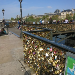 """Love"" locks have taken over bridges in Paris. The weight of all these locks is causing structural problems and the city has to cut them down and is replacing the wire with glass panels."
