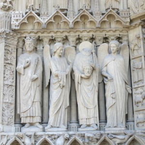 St Denis is the headless guy. The legend says he was decapitated, picked up his head, and walked 10k while preaching before he died.