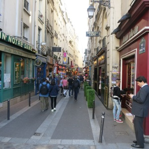 """A busy street in the Latin Quarter. By """"Latin,"""" they don't mean Hispanic but actually the dead language Latin because the area was full of academic nerds back in the day, speaking Latin!"""