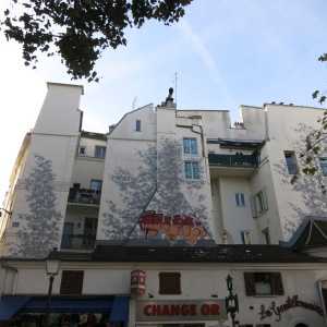 "The ""shadows"" on this wall are a mural; another great example of public art in Paris."