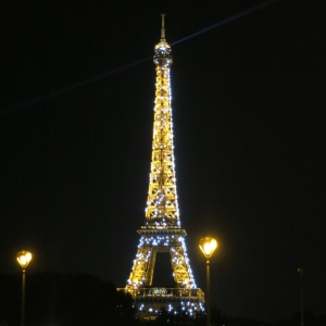 Eiffel Tower at night. At the top of the hour, it glitters.