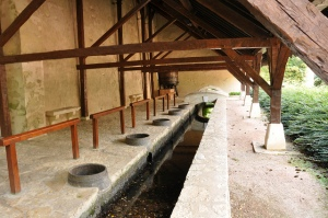"A medieval ""lavoir"" or public area people could come to do their laundry."
