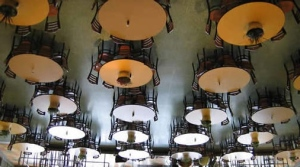 Looking up, the tables and chairs were actually suspended from the ceiling.