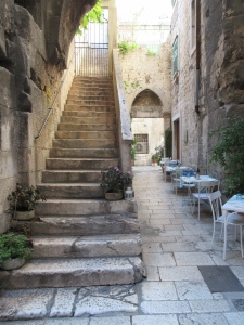 Inside the Palace. Stairs lead up to private residences, the passage on the right opens into a courtyard.