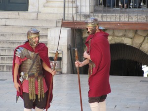 """Roman soldiers"" in the main square  pose for tips."