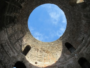 The vestibul where Diocletian would dress in royal robes and prepare for public appearances. The top of the domed roof has collapsed leaving a view to the sky.