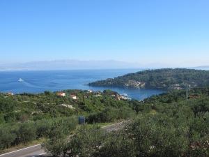 The ferry leaving tiny Rogač on Šolta Island returning to Split, seen in the distance.