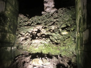 A wall of detritus in the cellars, yet to be excavated by archeologists. The passage in the foreground was excavated in the last 50 years, as was 90% of the cellars.