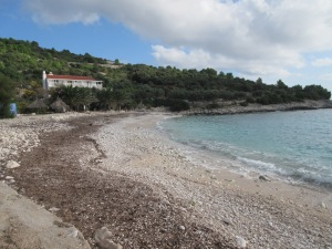 A typical rugged Croatian beach: white rocks, blue water.