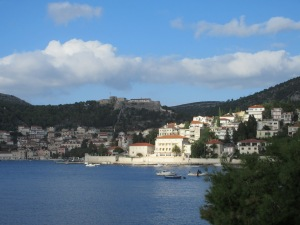Hvar town with the Venetian fortress perched on top of the hill. Note the old town wall running straight uphill to the fort.