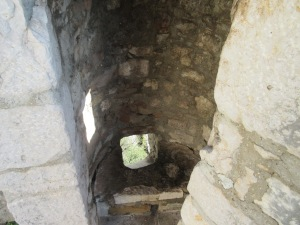 This small hole was a place for dumping hot oil on approaching attackers. Klis.