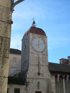 Clock tower overlooking main square in old Trogir.