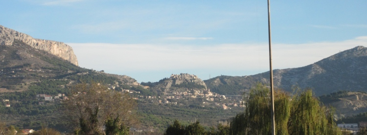 Klis Fortress, shot from the moving train, commanding the pass in the Dinaric Alps.