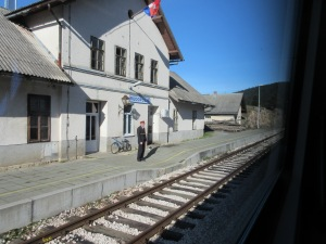On the train from Split to Zagreb, every small station en route had an attendant who flagged the train, even when we didn't stop.