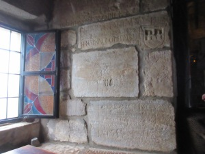 Inside the castle, Crusaders carved on the walls. The upper carving showing a crest is dated 1492..