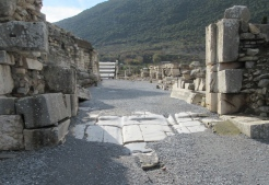 Grooves in the marble pavers from the passage of thousands of carts.
