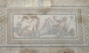 Floor mosaic of a woman riding a hippocampus, mythical Roman beast, and a god.