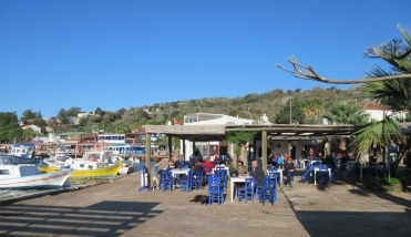 The busy municipal cafe in Gümüslük. Midday midweek off-season, it is busy with locals. Many of these cafes had people playing Rummikub or backgammon.