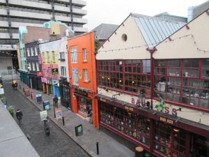 View from our balcony over Temple Bar. Sinead O'Connor worked as a waitress in the building on the right before her music career took off.
