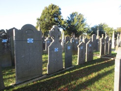 Glasnevin Cemetery is well cared for today. The blue tags indicate they have been repaired and restored.