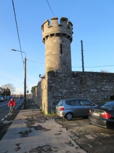 "A Glasnevin watchtower. A plaque at the base states: ""In the in 1840's, nightwatchmen on this tower successfully guarded the Cemetery against 'Resurrectionists' who supplied the medical profession with corpses for anatomy students."""