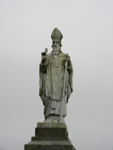 St. Patrick with his clover. This Brit not only brought Christianity to Ireland but also the Latin script and thus Ireland's first written language.