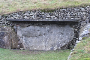 A carved stone at Newgrange. The meanings of these shapes are completely unknown.