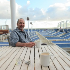 Jim enjoys his coffee and Megan her tea while supervising the deck chairs.